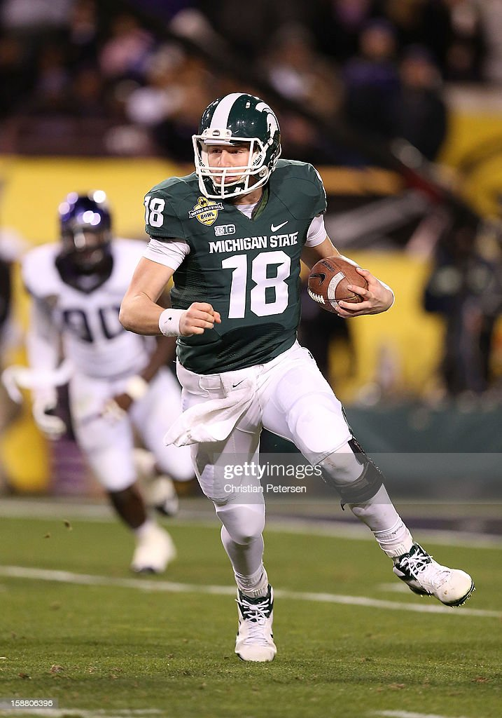 Quarterback Connor Cook #18 of the Michigan State Spartans scrambles with the football against the TCU Horned Frogs during the Buffalo Wild Wings Bowl at Sun Devil Stadium on December 29, 2012 in Tempe, Arizona. The Spartans defeated the Horned Frogs 17-16.