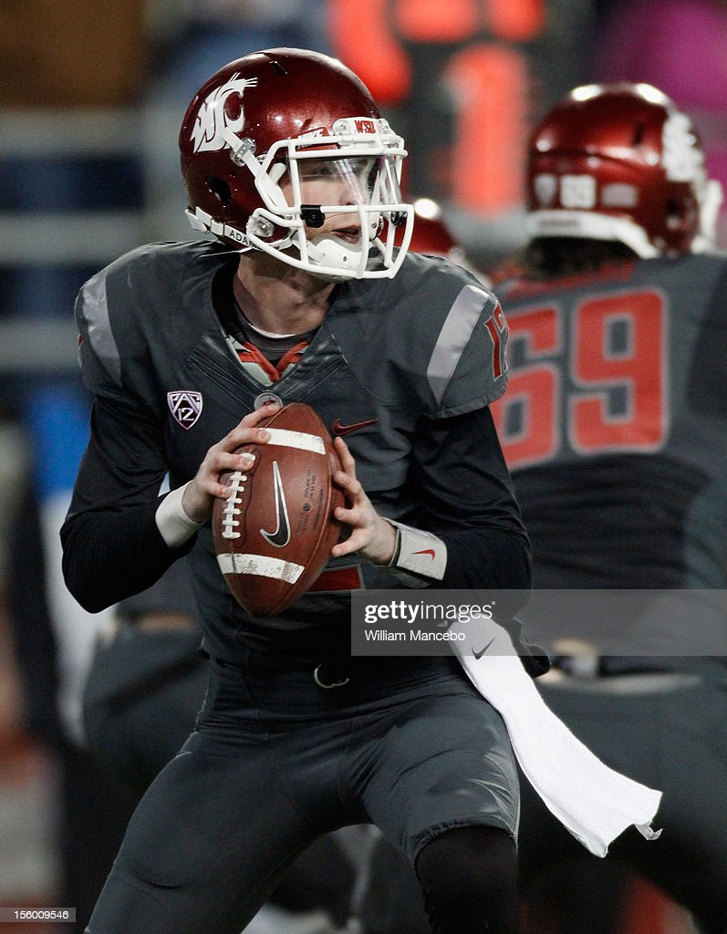Quarterback Connor Halliday #12 of the Washington State Cougars looks to pass the ball during the game against the UCLA Bruins at Martin Stadium on November 10, 2012 in Pullman, Washington.