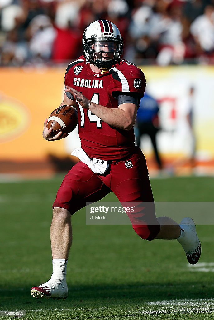 Quarterback Connor Shaw #14 of the South Carolina Gamecocks runs the ball against the Michigan Wolverines during the Outback Bowl Game at Raymond James Stadium on January 1, 2013 in Tampa, Florida.
