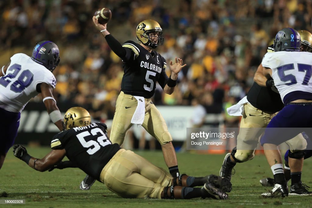 Quarterback Connor Wood #5 of the Colorado Buffaloes delivers a pass against the Central Arkansas Bears at Folsom Field on September 7, 2013 in Boulder, Colorado. The Buffaloes defeated the Bears 38-24.