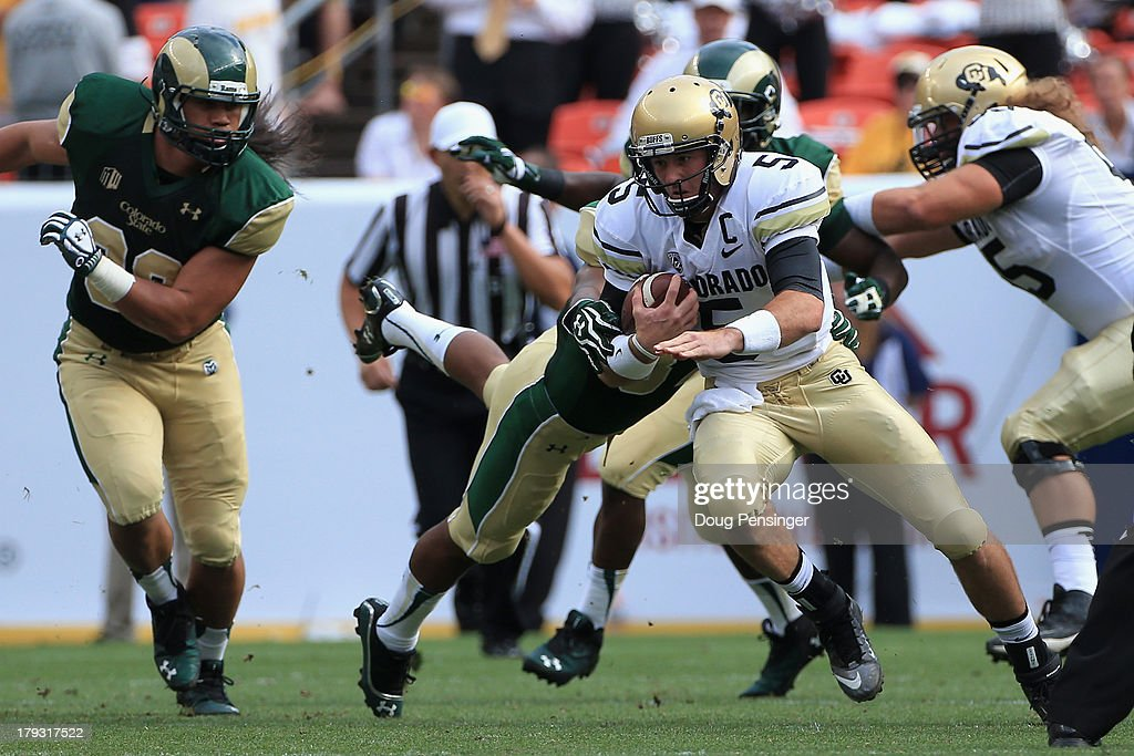 Quarterback Connor Wood #5 of the Colorado Buffaloes scrambles with the ball against the Colorado State Rams 2013 Rocky Mountain Showdown at Sports Authority Field at Mile High on September 1, 2013 in Denver, Colorado.