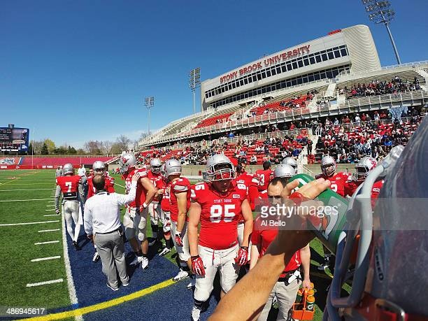 Quarterback Conor Bednarski of the Stony Brook Offense drinks water during a time out during their Spring Football Game at Kenneth P LaValle Stadium...