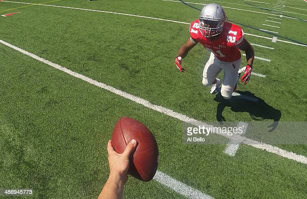 Quarterback Conor Bednarski of the Stony Brook Offense hands the ball to Running Back Stacey Bedell during their Spring Football Game at Kenneth P...