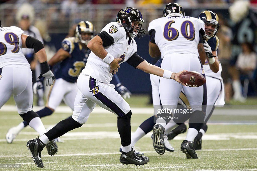 Quarterback <a gi-track='captionPersonalityLinkClicked' href=/galleries/search?phrase=Curtis+Painter&family=editorial&specificpeople=2156169 ng-click='$event.stopPropagation()'>Curtis Painter</a> #8 of the Baltimore Ravens hands off to a running back during the game against the St. Louis Rams at the Edward Jones Dome on August 30, 2012 in St. Louis, Missouri. The St. Louis Rams defeated the Baltimore Ravens 31-17.