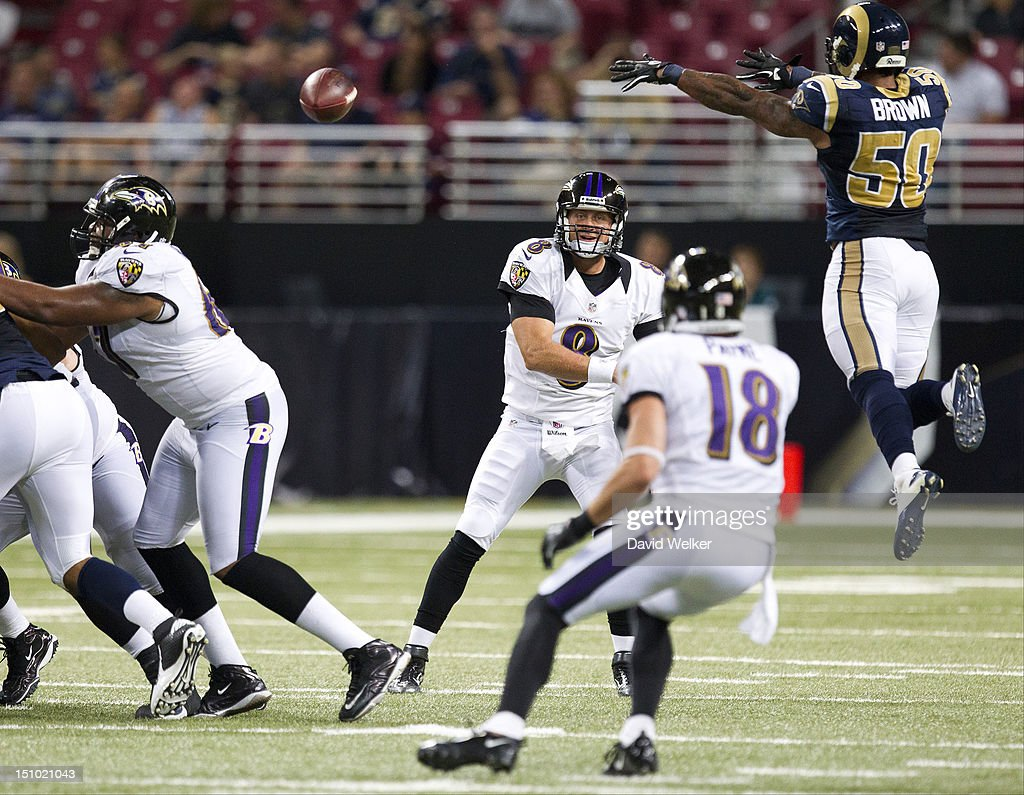 Quarterback <a gi-track='captionPersonalityLinkClicked' href=/galleries/search?phrase=Curtis+Painter&family=editorial&specificpeople=2156169 ng-click='$event.stopPropagation()'>Curtis Painter</a> #8 of the Baltimore Ravens throws to wide receiver Logan Payne #18 as linebacker Aaron Brown #50 of the St. Louis Rams leaps to block the pass during the game against the St. Louis Rams at the Edward Jones Dome on August 30, 2012 in St. Louis, Missouri. The St. Louis Rams defeated the Baltimore Ravens 31-17.