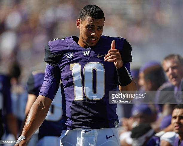 Quarterback Cyler Miles of the Washington Huskies flashes the thumbs up sign on the sidelines late in the game against the Illinois Fighting Illini...