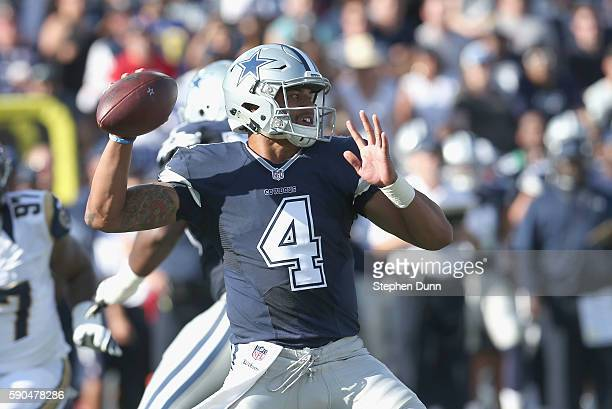 Quarterback Dak Prescott of the Dallas Cowboys throws a pass against the Los Angeles Rams at the Los Angeles Coliseum during preseason on August 13...