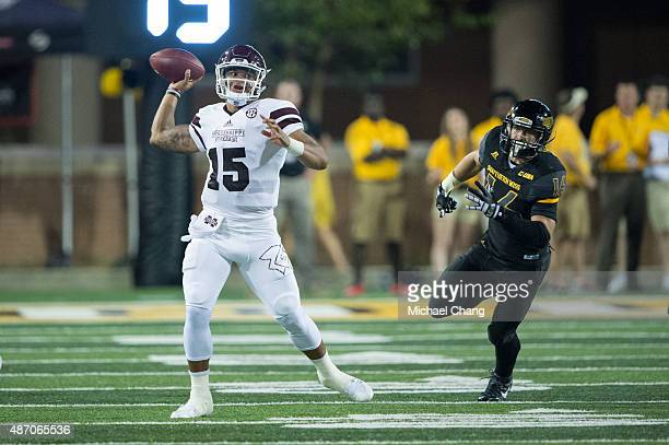 Quarterback Dak Prescott of the Mississippi State Bulldogs looks to throw a pass in front of linebacker Elijah Parker of the Southern Miss Golden...