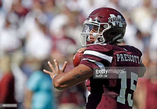 Quarterback Dak Prescott of the Mississippi State Bulldogs looks to throw a pass during the second quarter of an NCAA college football game against...