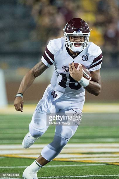 Quarterback Dak Prescott of the Mississippi State Bulldogs runs the ball down field during their game against the Southern Miss Golden Eagles on...