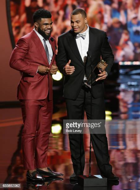 Quarterback Dak Prescott right excepts the AP Offensive Rookie of the Year with this teammate Ezekiel Elliot during the NFL Honors at the Wortham...