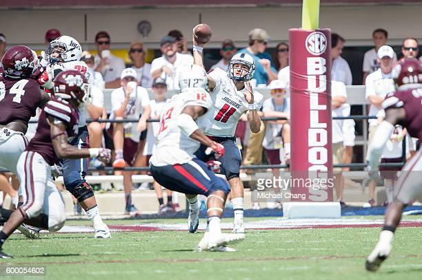Quarterback Dallas Davis of the South Alabama Jaguars throws a pass to tight end Gerald Everett of the South Alabama Jaguars during their game...