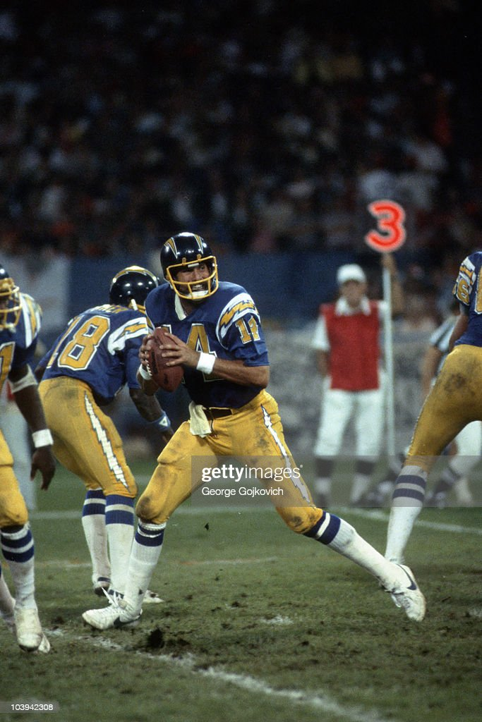 Quarterback <a gi-track='captionPersonalityLinkClicked' href=/galleries/search?phrase=Dan+Fouts&family=editorial&specificpeople=228594 ng-click='$event.stopPropagation()'>Dan Fouts</a> #14 of the San Diego Chargers drops back to pass against the Cleveland Browns during a Monday Night Football game at Municipal Stadium on September 7, 1981 in Cleveland, Ohio.