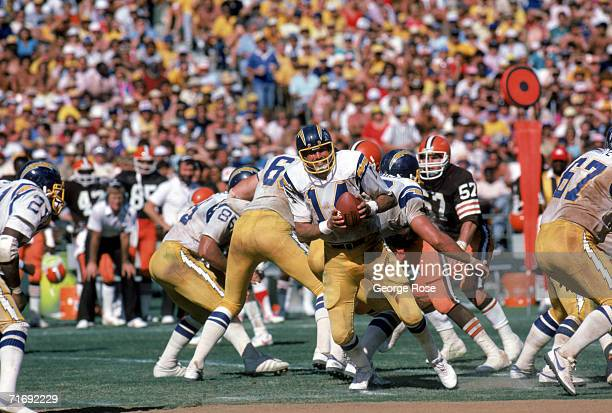 Quarterback Dan Fouts of the San Diego Chargers runs a play during a game against the Cleveland Browns at Jack Murphy Stadium on September 25 1983 in...