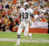 Quarterback Dan Marino of the Miami Dolphins goes back to pass in a game against the Los Angeles Raiders on December 2 l984 in Miami Florida