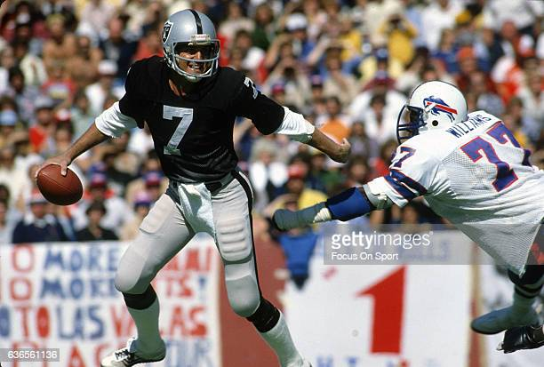 Quarterback Dan Pastorini of the Oakland Raiders scrambles away from the pressure of Ben Williams of the Buffalo Bills during an NFL football game...