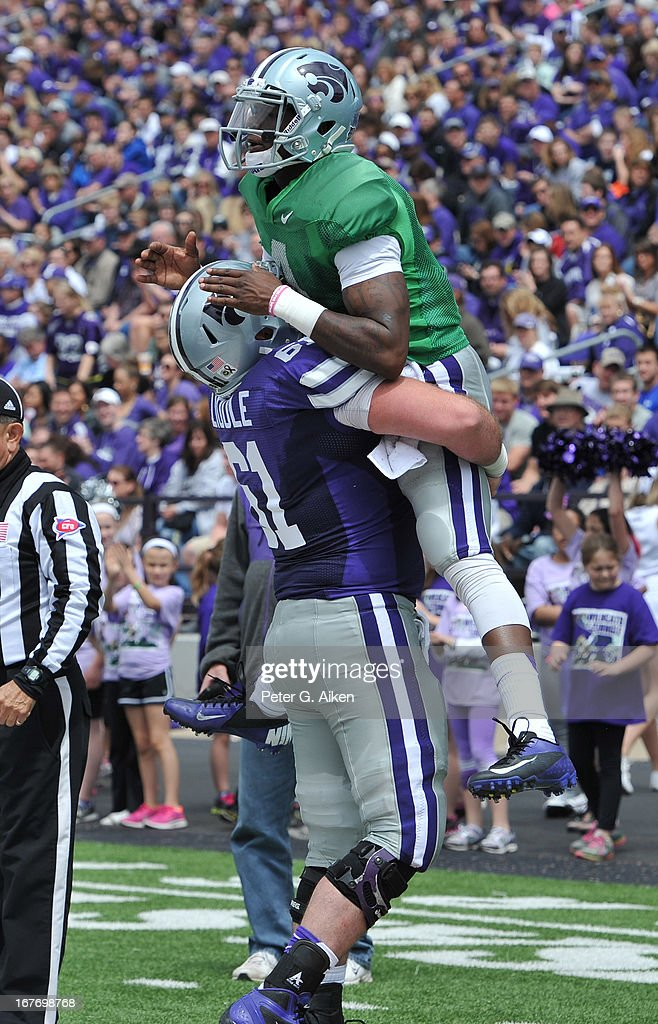 Quarterback Daniel Sams #4 of the Kansas State Wildcats celebrates after scoring a touchdown with teammate Drew Liddle #61 during the Purple and White Spring Game on April 27, 2013 at Bill Snyder Family Stadium in Manhattan, Kansas.