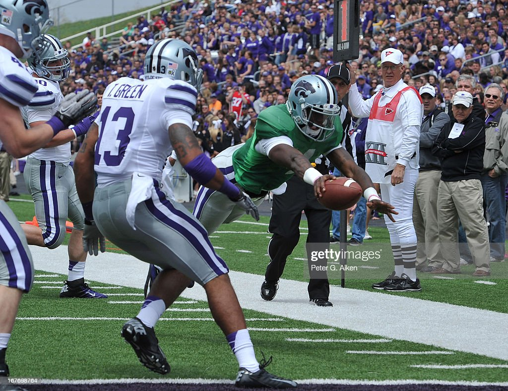 Quarterback Daniel Sams #4 of the Kansas State Wildcats dives to the end zone for a touchdown durng the Purple and White Spring Game on April 27, 2013 at Bill Snyder Family Stadium in Manhattan, Kansas.