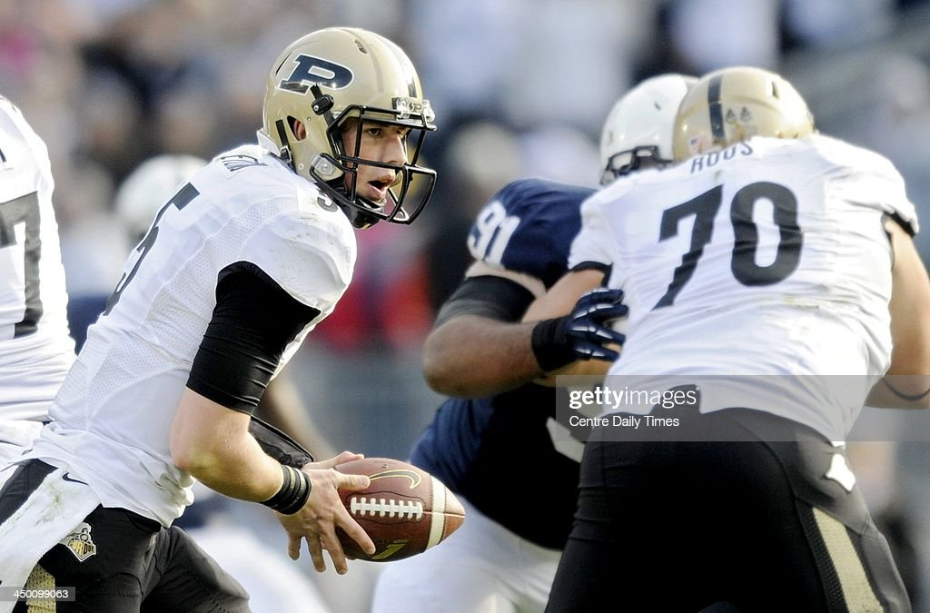 Quarterback Danny Etling of Purdue looks to hand off the ball. The Penn State Nittany Lions defeated the Purdue Boilermakers, 45-21, at Beaver Stadium in State College, Pa., on Saturday, Nov. 16, 2013.