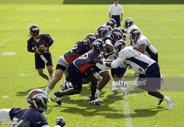 Quarterback Danny Kanell of the Denver Broncos runs a play during the first full session of training camp at Dove Valley on July 28 2004 in Englewood...