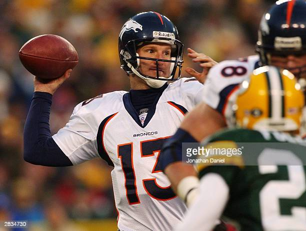 Quarterback Danny Kanell of the Denver Broncos throws a pass during a game against the Green Bay Packers on December 28 2003 at Lambeau Field in...