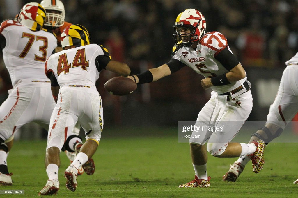 Quarterback Danny O'Brien #5 of the Maryland Terrapins hands the ball off to running back Justus Pickett #44 during the first half against the Miami Hurricanes at Byrd Stadium on September 5, 2011 in College Park, Maryland.