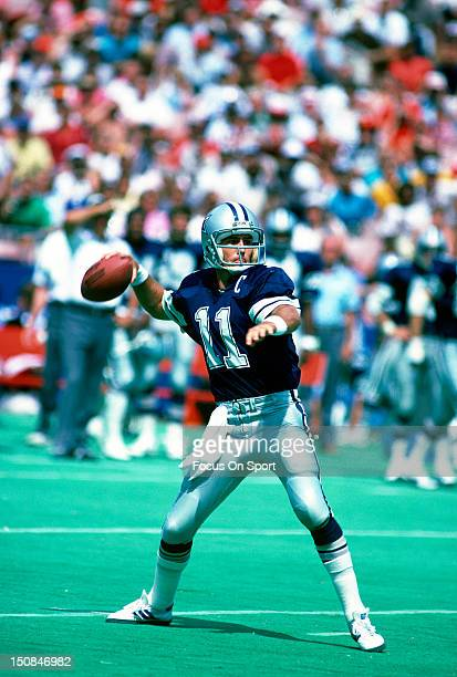Quarterback Danny White of the Dallas Cowboys drops back to pass against the St Louis Cardinals during an NFL football game at Busch Stadium...