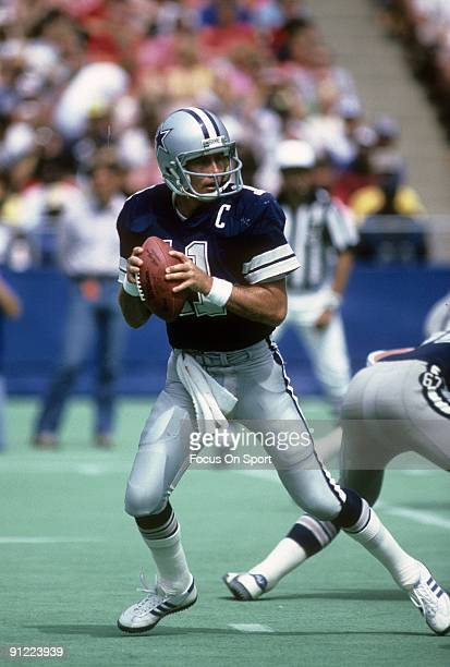 Quarterback Danny White of the Dallas Cowboys drops back to pass against the New York Giants during a NFL football game October 30 1983 at Giant...