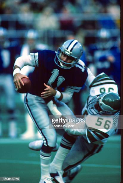 Quarterback Danny White of the Dallas Cowboys gets sacked by Jerry Robinson of the Philadelphia Eagles during an NFL football game at Veterans...