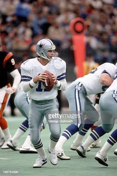Quarterback Danny White of the Dallas Cowboys looks to pass against the Cincinnati Bengals at Riverfront Stadium on December 8 1985 in Cincinnati...