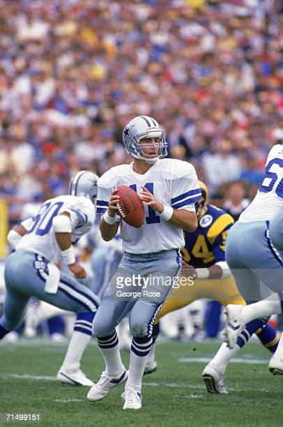 Quarterback Danny White of the Dallas Cowboys looks to pass during a 1985 NFC Divisional Playoff game against the Los Angeles Rams at Anaheim Stadium...