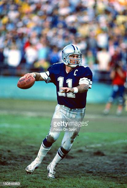 Quarterback Danny White of the Dallas Cowboys rolls out to pass against the San Diego Chargers during an NFL football game at Jack Murphy Stadium...