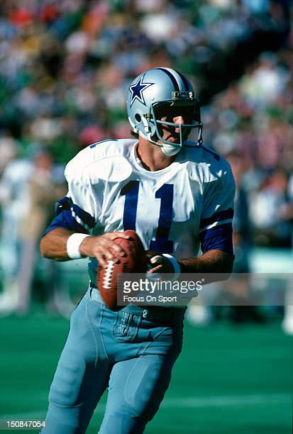 Quarterback Danny White of the Dallas Cowboys rolls out to pass against the Philadelphia Eagles during an NFL football game at Veterans Stadium circa...