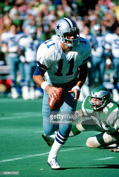 Quarterback Danny White of the Dallas Cowboys runs with the ball against the Philadelphia Eagles during an NFL football game at Veterans Stadium...