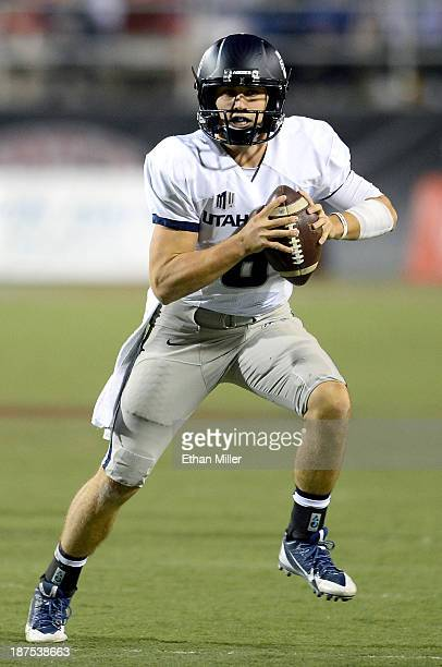 Quarterback Darell Garretson of the Utah State Aggies scrambles against the UNLV Rebels during their game at Sam Boyd Stadium on November 9 2013 in...