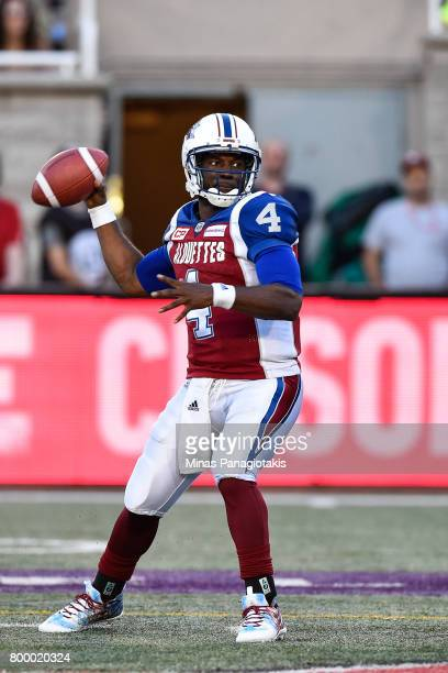 Quarterback Darian Durant of the Montreal Alouettes looks to play the ball against the Saskatchewan Roughriders in the first half during the CFL game...