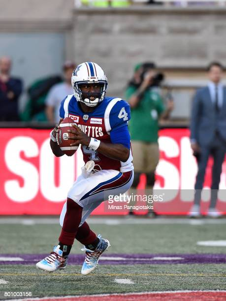 Quarterback Darian Durant of the Montreal Alouettes looks to play the ball against the Saskatchewan Roughriders during the CFL game at Percival...