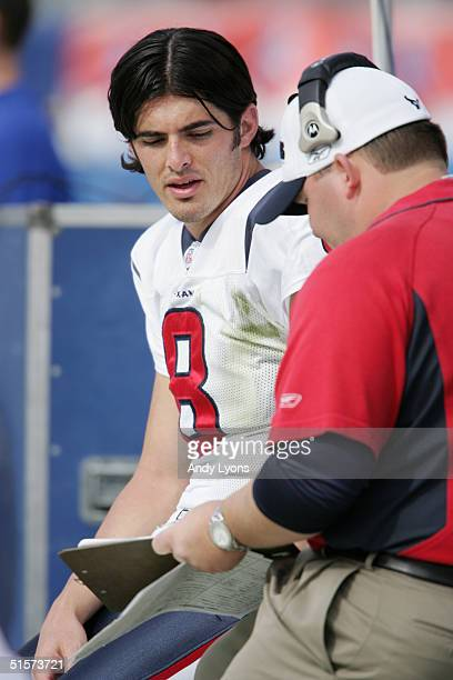 Quarterback David Carr of the Houston Texans sits on the sidelines during the game against the Tennessee Titans at The Coliseum on October 2 2004 in...