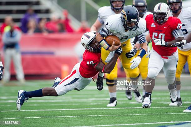 Quarterback David Fisher of the Kent State Golden Flashes goes airborne after being tackled by cornerback Montell Garner of the South Alabama Jaguars...