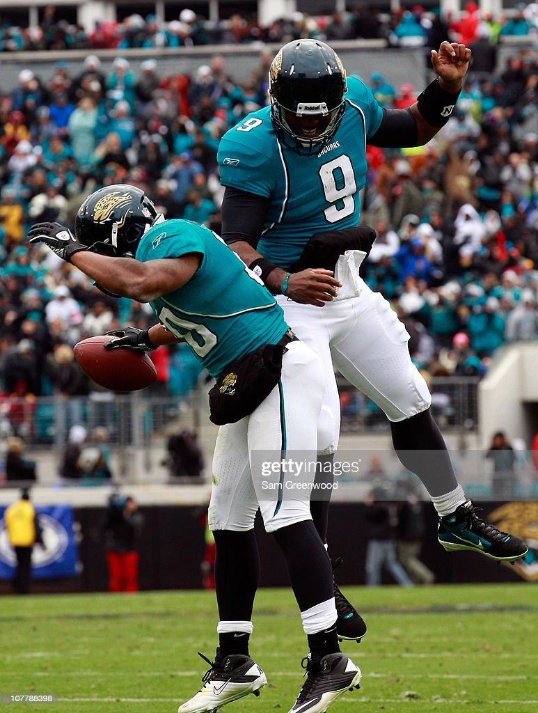 Quarterback David Garrard #9 and Mike Thomas #80 of the jacksonville Jaguars celebrate following a touchdown during the game against the Washington Redskins at EverBank Field on December 26, 2010 in Jacksonville, Florida.