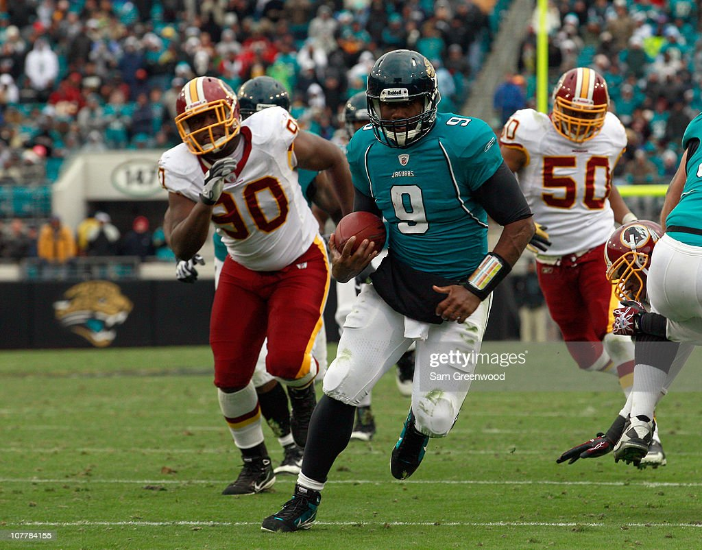 Quarterback <a gi-track='captionPersonalityLinkClicked' href=/galleries/search?phrase=David+Garrard&family=editorial&specificpeople=182496 ng-click='$event.stopPropagation()'>David Garrard</a> #9 of the Jacksonville Jaguars runs for a touchdaown during the game against the Washington Redskins at EverBank Field on December 26, 2010 in Jacksonville, Florida.