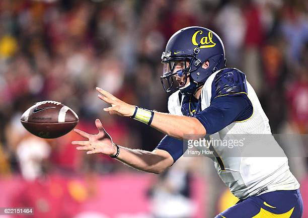 Quarterback Davis Webb of the California Golden Bears takes a snap during the game against the USC Trojans at Los Angeles Coliseum on October 27 2016...