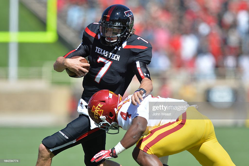 Quarterback Davis Webb #7 of the Texas Tech Red Raiders is tackled by Sam E. Richardson #4 of the Iowa State Cyclones during game action on October 12, 2013 at AT&T Jones Stadium in Lubbock, Texas. Texas Tech won the game over Iowa State 42-35.