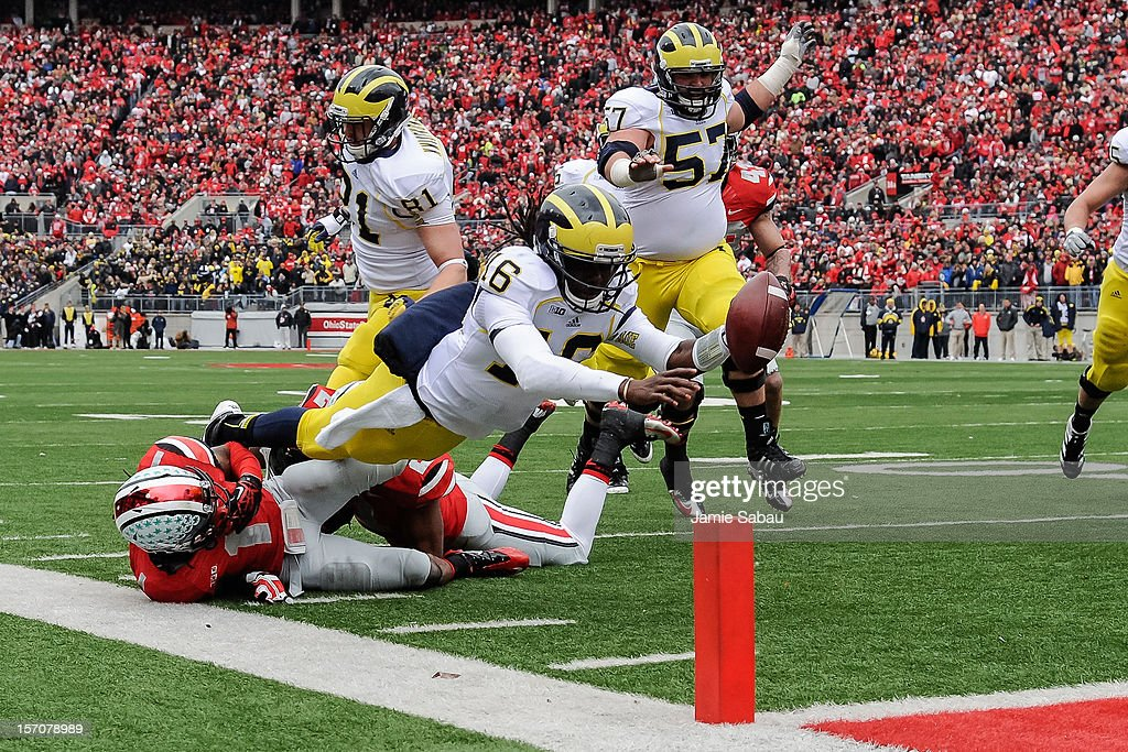 Quarterback Denard Robinson #16 of the Michigan Wolverines dives for the goal line against the Ohio State Buckeyes at Ohio Stadium on November 24, 2012 in Columbus, Ohio. Robinson fell short of the goal line.