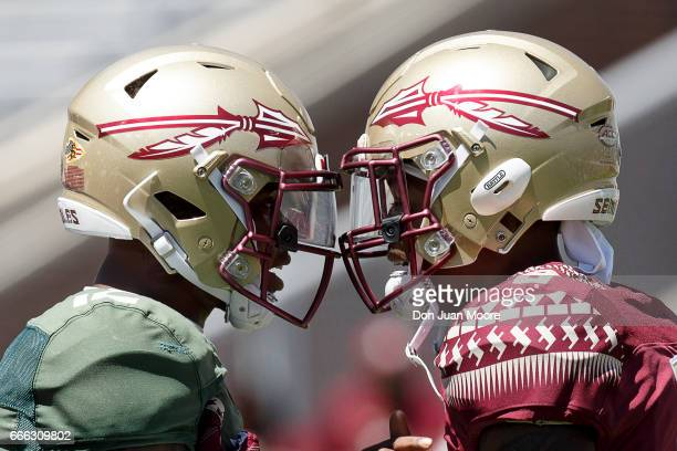 Quarterback Deondre Francois and Wide Receiver Nyqwan Murray of the Florida State Seminoles go helmet to helmet before the start of the annual Garnet...