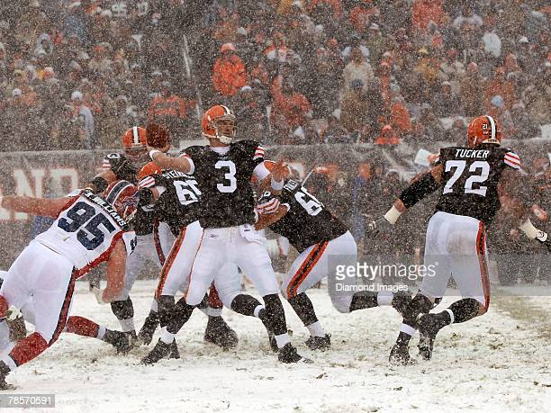 Quarterback Derek Anderson of the Cleveland Browns passes under pressure from defensive lineman Kyle Williams of the Buffalo Bills as as offensive...