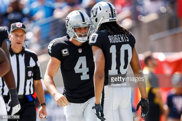 Quarterback Derek Carr and wide receiver Seth Roberts of the Oakland Raiders against the Tennessee Titans in the second half at Nissan Stadium on...