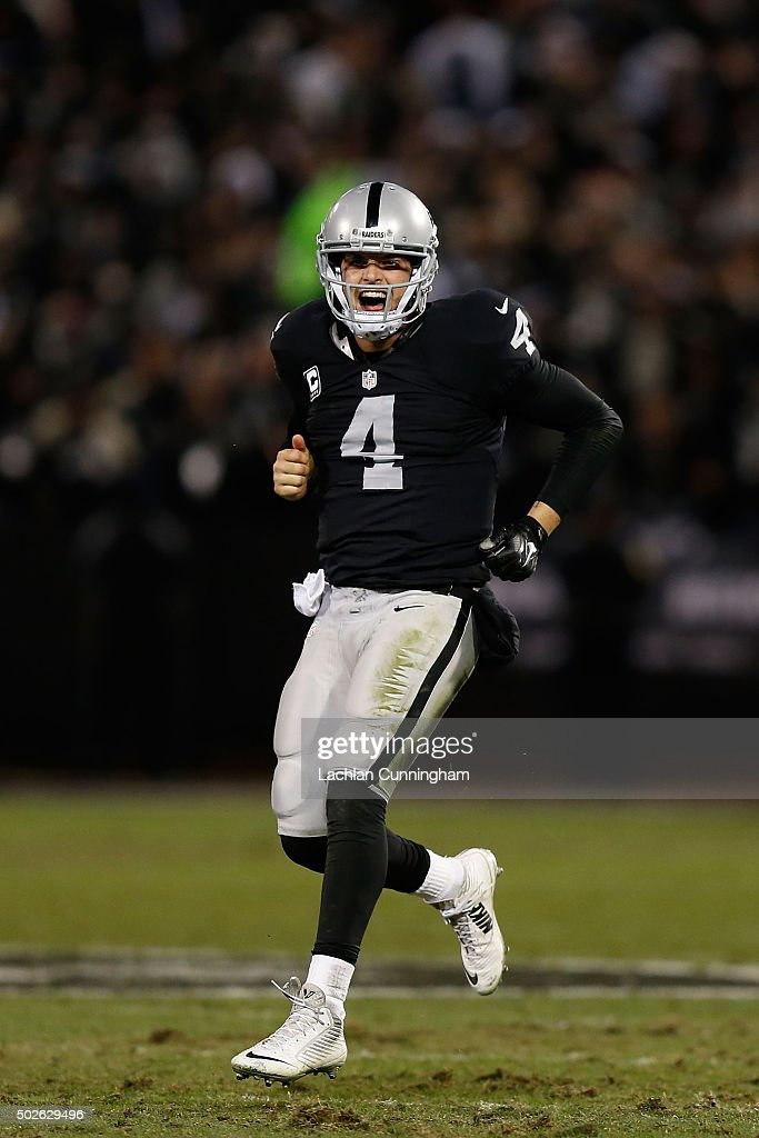 Quarterback Derek Carr #4 of the Oakland Raiders celebrates a 2-point conversion in the fourth quarter against the San Diego Chargers at O.co Coliseum on December 24, 2015 in Oakland, California.