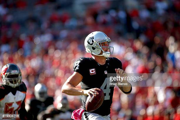 Quarterback Derek Carr of the Oakland Raiders looks for a receiver during the fourth quarter of an NFL game against the Tampa Bay Buccaneers on...