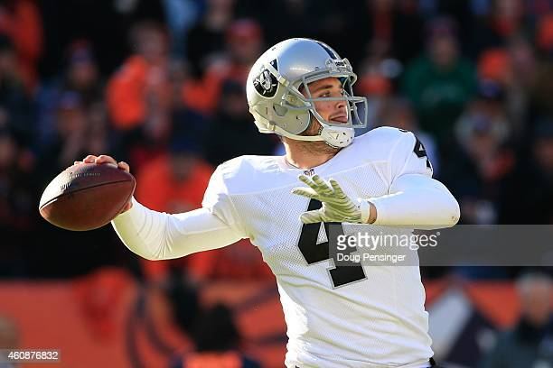 Quarterback Derek Carr of the Oakland Raiders passes against the Denver Broncos during a game at Sports Authority Field at Mile High on December 28...